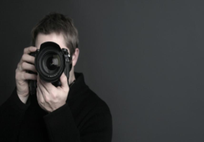 9. Fotoreportér