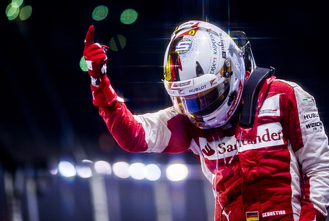Sebastian Vettel of Germany and Scuderia Ferrari celebrates in Parc Ferme after winning the Singapore Formula One Grand Prix at Marina Bay Circuit on September 20, 2015 in Singapore, Singapore. (Photograph by Vladimir Rys)