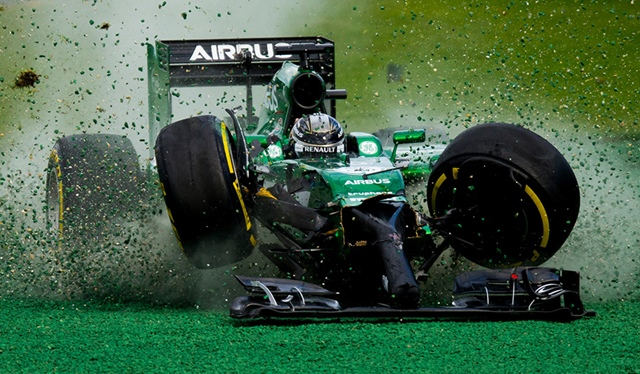 Kamui Kobayashi of Japan and Caterham gets off the track after his crash with Felipe Massa of Brazil and Williams during the Australian Formula One Grand Prix at Albert Park Circuit on March 16, 2014 in Melbourne, Australia. (Photo by Vladimir Rys)